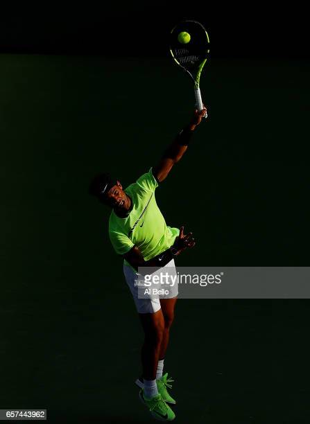 Rafael Nadal of Spain seves against Dudi Sela of Israel during day 5 of the Miami Open at Crandon Park Tennis Center on March 24 2017 in Key Biscayne...