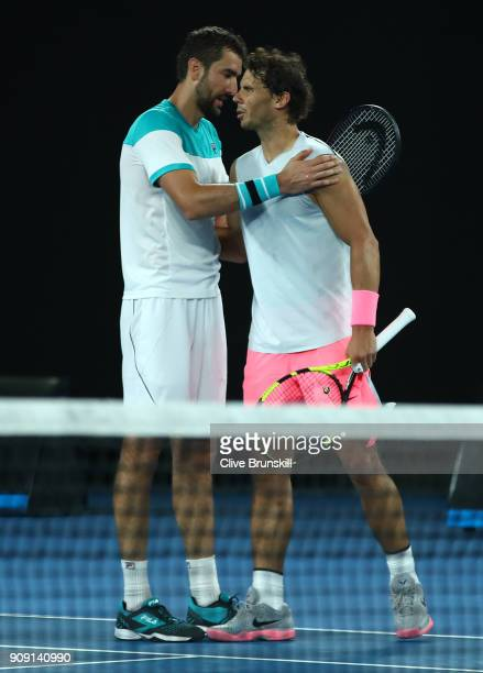 Rafael Nadal of Spain shakes hands after retiring injured during the fifth set in his quarterfinal match against Marin Cilic of Croatia on day nine...