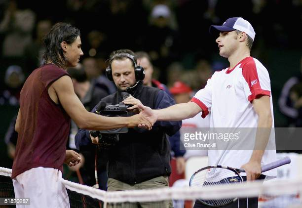 Rafael Nadal of Spain shakes hands at the net after his four set victory over Andy Roddick of the USA in the second rubber during the Davis Cup by...