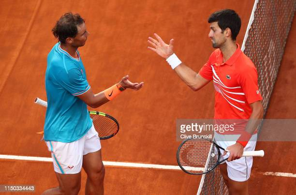 Rafael Nadal of Spain shakes hands at the net after his three set victory against Novak Djokovic of Serbia in the men's final during day eight of the...