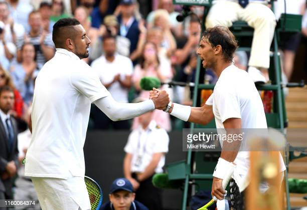 Rafael Nadal of Spain shakes hands at the net with Nick Kyrgios of Australia after their Men's Singles second round match during Day four of The...
