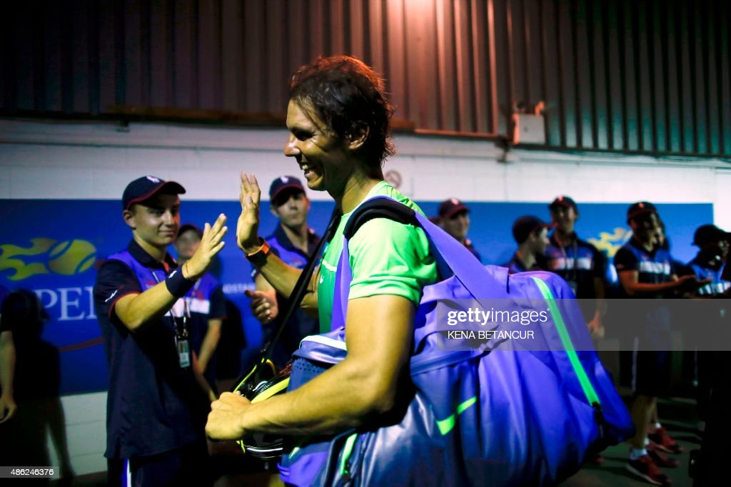 Rafael Nadal of Spain shake hands with a group of ball boys after he defeated Diego Schwartzman of Argentina during their 2015 US Open Men's Singles round 2 match at the USTA Billie Jean King National Tennis Center September 2, 2015 in New York. AFP PHOTO/KENA BETANCUR / AFP PHOTO / Kena BETANCUR