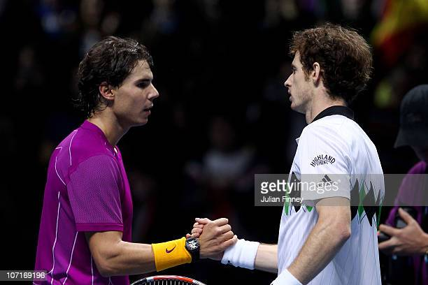 Rafael Nadal of Spain shakes hands with Andy Murray of Great Britain after winning his men's semifinal match during the ATP World Tour Finals at O2...