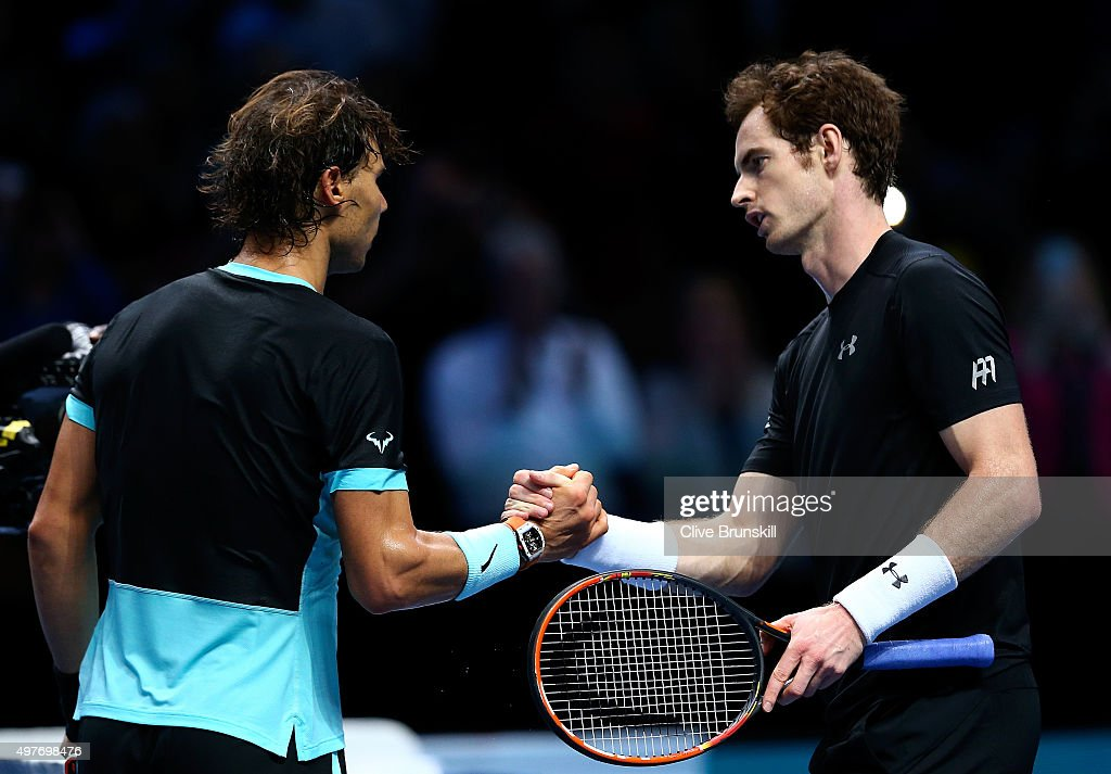 Rafael Nadal of Spain (L) shakes hands with Andy Murray of Great Britain (R) after his victory in their men's singles match during day four of the Barclays ATP World Tour Finals at the O2 Arena on November 18, 2015 in London, England.