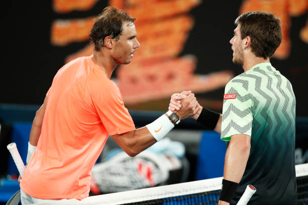 Rafael Nadal of Spain shakes hands with Cameron Norrie of Great Britain after their Men's Singles third round match during day six of the 2021...