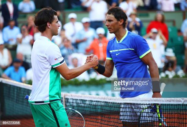 Rafael Nadal of Spain shakes hands with Dominic Thiem of Austria following his victory during their men's singles semi final match on day thirteen of...