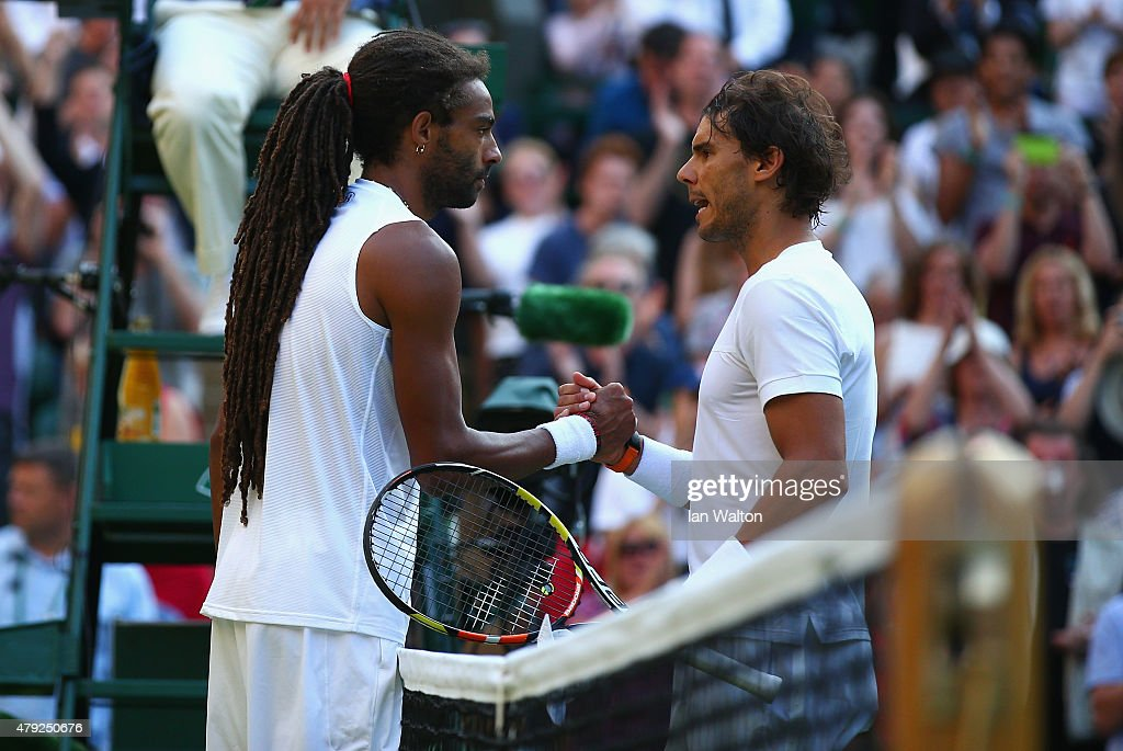 Rafael Nadal (R) of Spain shakes hands with Dustin Brown of Germany after losing his Gentlemens Singles Second Round match during day four of the Wimbledon Lawn Tennis Championships at the All England Lawn Tennis and Croquet Club on July 2, 2015 in London, England.