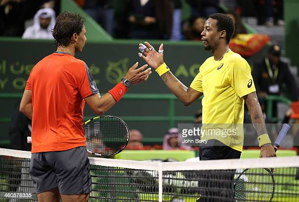 Rafael Nadal of Spain shakes hands with Gael Monfils of France after beating him in 3 sets in the final of the Qatar ExxonMobil Open 2014 held at the...
