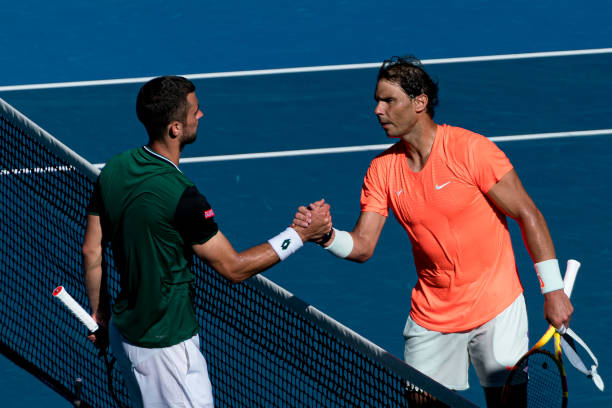 Rafael Nadal of Spain shakes hands with his opponent in his Men's Singles first round match against Laslo Djere of Serbia during day two of the 2021...