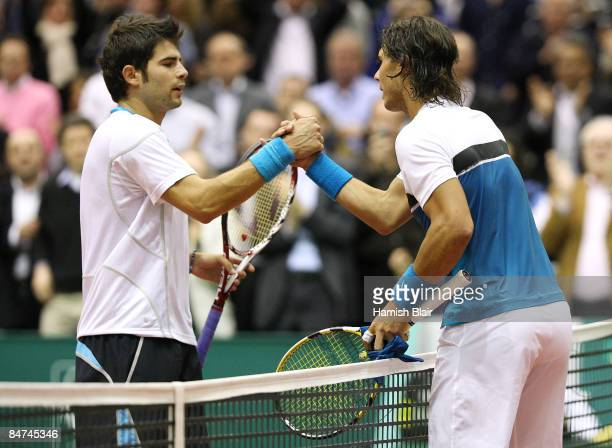 Rafael Nadal of Spain shakes hands with his opponent Simone Bolelli of Italy after their match during day three of the ABN AMRO World Tennis...