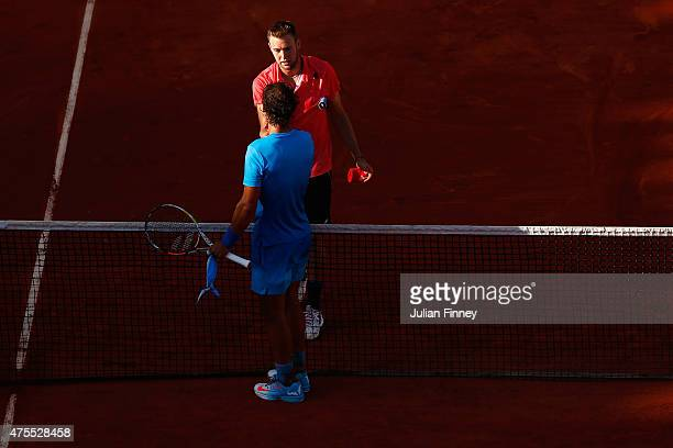 Rafael Nadal of Spain shakes hands with Jack Sock of the United States after beating him im their Men's Singles match on day nine of the 2015 French...