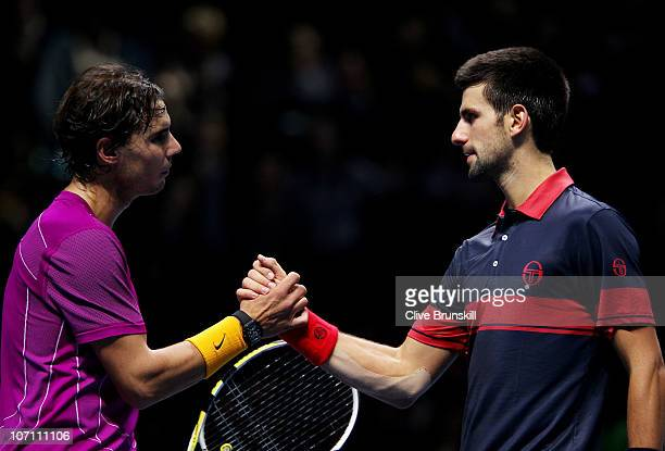 Rafael Nadal of Spain shakes hands with Novak Djokovic of Serbia winning his men's singles match during ATP World Tour Finals at O2 Arena on November...