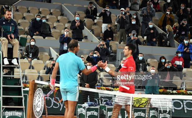 Rafael Nadal of Spain shakes hands with Novak Djokovic of Serbia after winning the men's singles final on day fifteen of the 2020 French Open at...