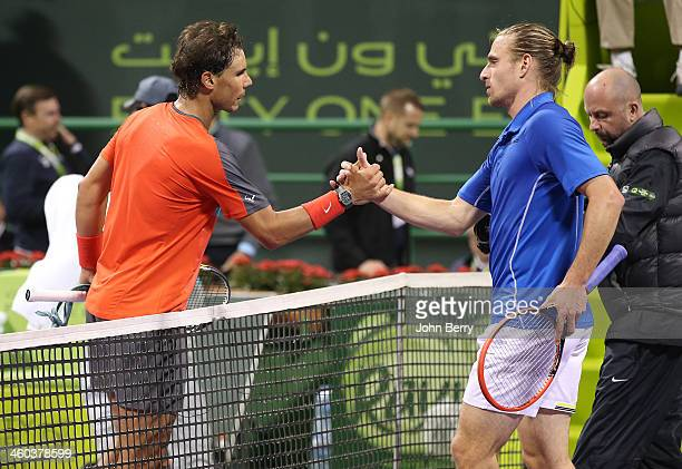 Rafael Nadal of Spain shakes hands with Peter Gojowczyk of Germany after their semifinal during the Qatar ExxonMobil Open 2014 held at the Khalifa...