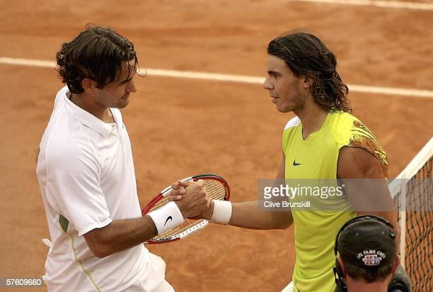 Rafael Nadal of Spain shakes hands with Roger Federer of Switzerland, at the net, after defeating him in the final of the ATP Masters Series on May...