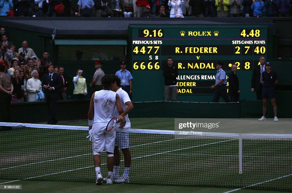 Rafael Nadal of Spain shakes hands with Roger Federer of Switzerland after Nadal won in five sets in the final on day thirteen of the Wimbledon Lawn Tennis Championships at the All England Lawn Tennis and Croquet Club on July 6, 2008 in London, England.