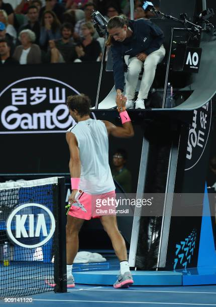 Rafael Nadal of Spain shakes hands with the chair umpire after retiring injured during the fifth set in his quarterfinal match against Marin Cilic of...