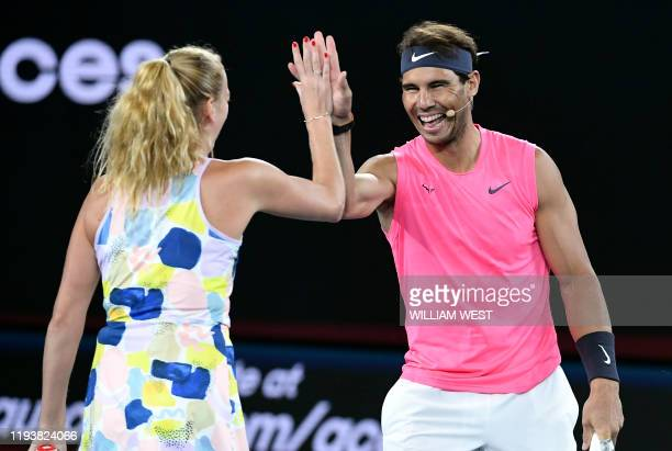 Rafael Nadal of Spain share a lighter moment with Petra Kvitova of the Czech Republic as they and other top players play in the Rally for Relief...