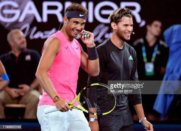 Rafael Nadal of Spain shares a lighter moment with Dominic Thiem of Belgium as they and other top players play in the Rally for Relief charity tennis...