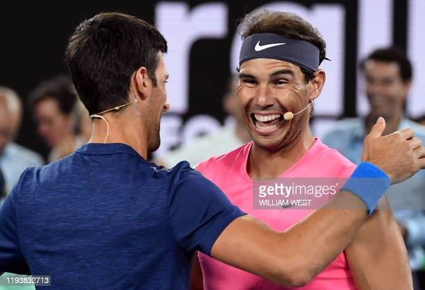 TOPSHOT Rafael Nadal of Spain shares a lighter moment with Novak Djokovic of Serbia as they and the world's top players play in the Rally for Relief...