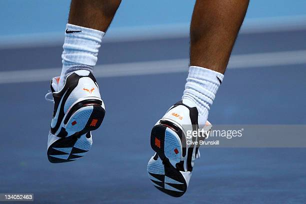 Rafael Nadal of Spain shoes are seen as he serves during the men's singles match against JoWilfried Tsonga of France during the Barclays ATP World...