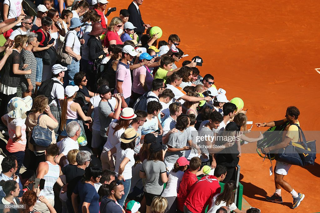 Rafael Nadal of Spain signs autographs after the doubles victory with Fernando Verdasco of Spain against Philipp Kohlschreiber of Germany and Viktor Troicki of Serbia during day two of the Monte Carlo Rolex Masters at Monte-Carlo Sporting Club on April 11, 2016 in Monte-Carlo, Monaco.