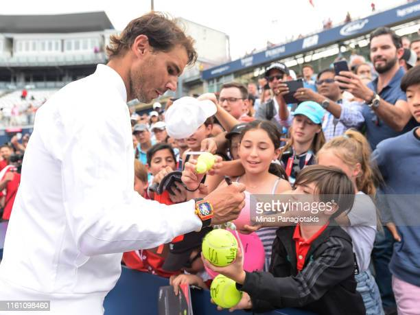 Rafael Nadal of Spain signs autographs for fans after his win against Daniil Medvedev of Russia during the mens singles final on day 10 of the Rogers...