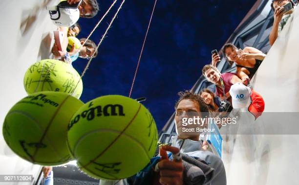 Rafael Nadal of Spain signs autographs for supporters in the crowd after winning his third round match against Damir Dzumhur of Bosnia and...