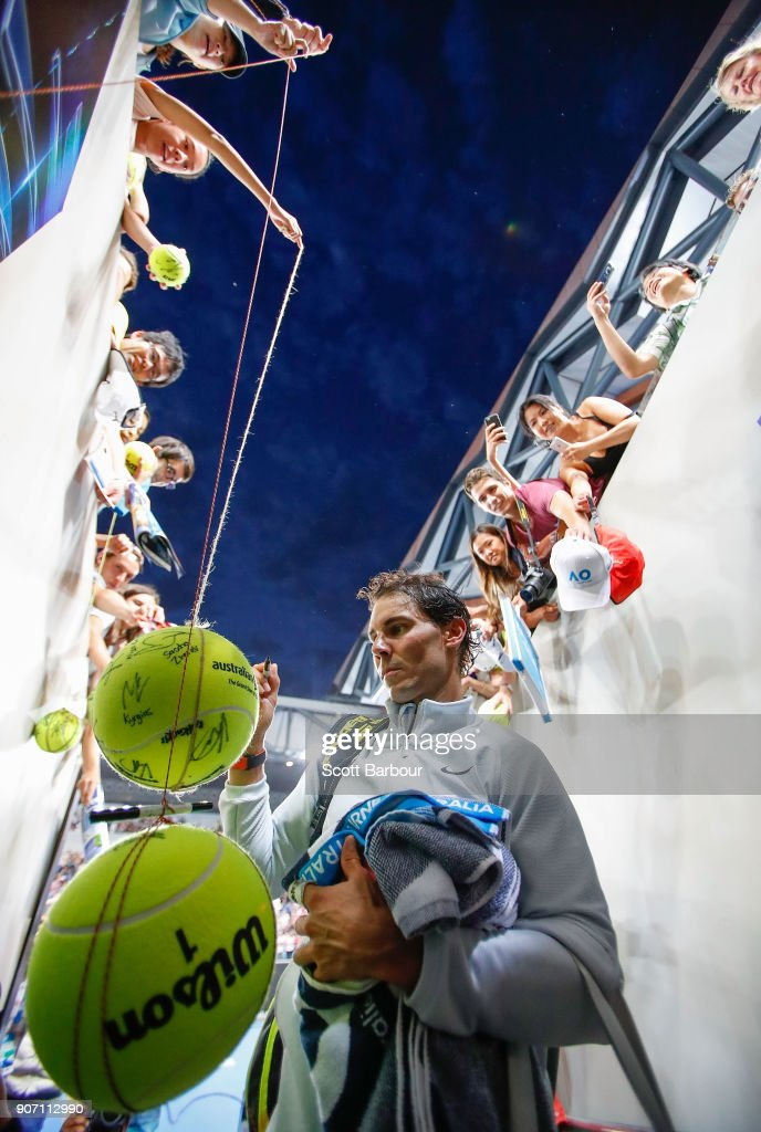 Rafael Nadal of Spain signs autographs for supporters in the crowd after winning his third round match against Damir Dzumhur of Bosnia and Herzogovina on day five of the 2018 Australian Open at Melbourne Park on January 19, 2018 in Melbourne, Australia.