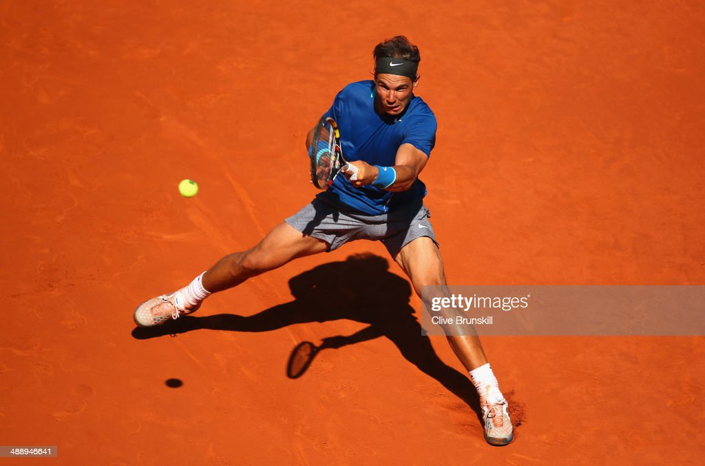 Rafael Nadal of Spain slides to play a forehand against Tomas Berdych of the Czech Republic in their quarter final match during day seven of the Mutua Madrid Open tennis tournament at the Caja Magica on May 9, 2014 in Madrid, Spain.