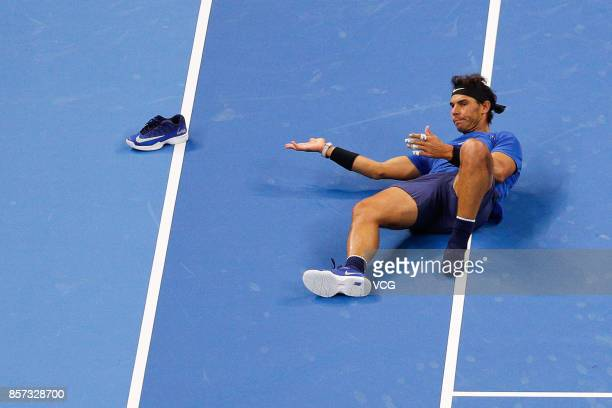 Rafael Nadal of Spain slips and falls down during the Men's singles first round match against Lucas Pouille of France on day four of 2017 China Open...