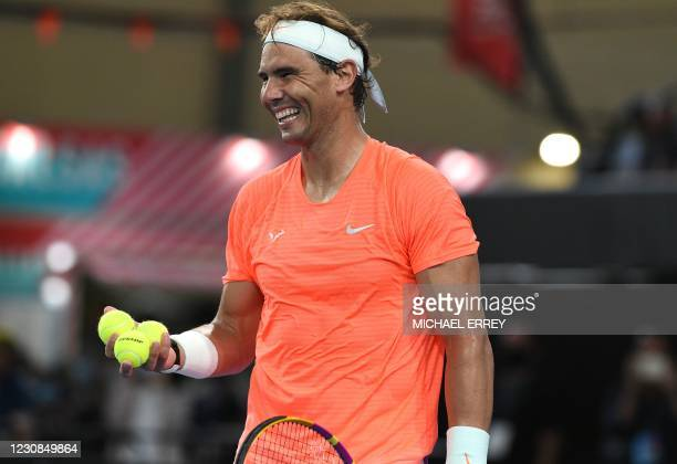 Rafael Nadal of Spain smiles as he gets ready to serve against Dominic Thiem of Austria during the 'A Day at the Drive' exhibition match in Adelaide...