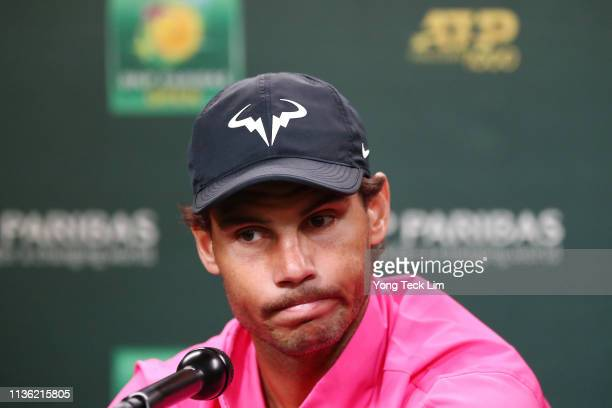 Rafael Nadal of Spain speaks to members of the media after withdrawing from his men's singles semifinal match against Roger Federer of Switzerland...