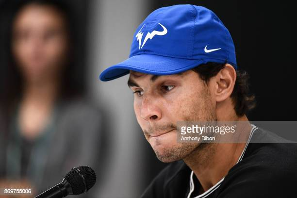 Rafael Nadal of Spain speaks to the media to announce he is pulling out of the tournament with injury during the Day 5 of the Rolex Paris Masters at...