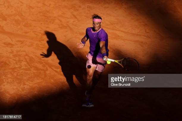 Rafael Nadal of Spain splauys a forehand in their mens singles third round match against Denis Shapovalov of Canada during Day Six of the...
