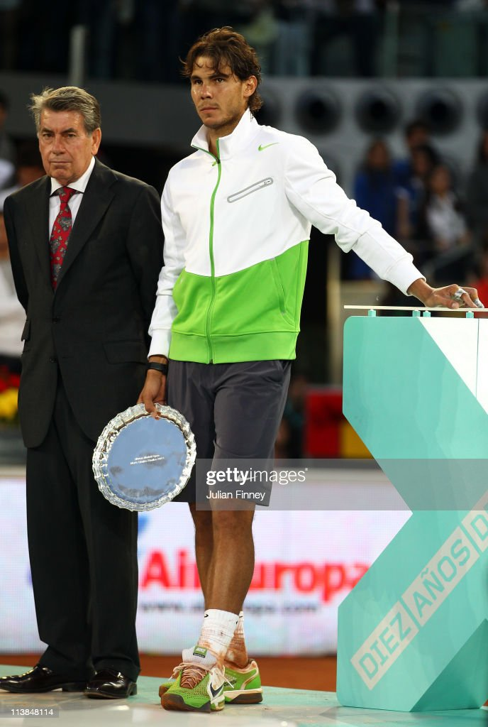 Rafael Nadal of Spain stands next to Monolo Santana after Nadal lost to Novak Djokovic of Serbia in the final during day nine of the Mutua Madrilena Madrid Open Tennis on May 8, 2011 in Madrid, Spain.