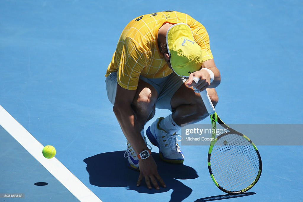 Rafael Nadal of Spain stops to feel his ankle after hitting during a practice session ahead of the 2016 Australian Open at Melbourne Park on January 16, 2016 in Melbourne, Australia.