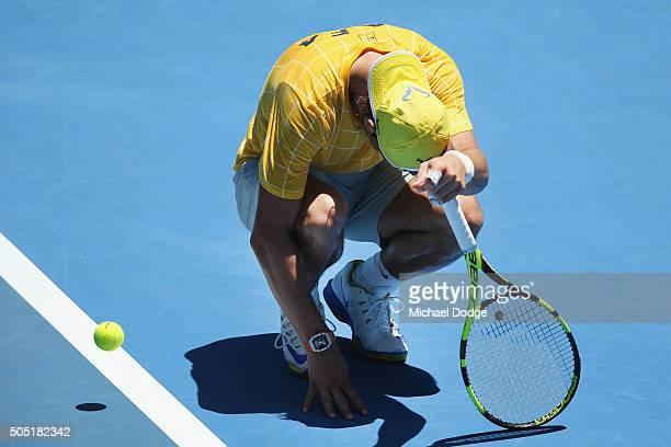 Rafael Nadal of Spain stops to feel his ankle after hitting during a practice session ahead of the 2016 Australian Open at Melbourne Park on January...