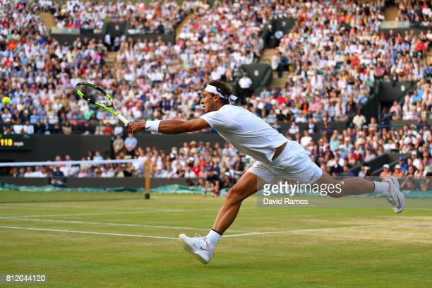 Rafael Nadal of Spain stretches as he plays a forehand during the Gentlemen's Singles fourth round match against Gilles Muller of Luxembourg on day...