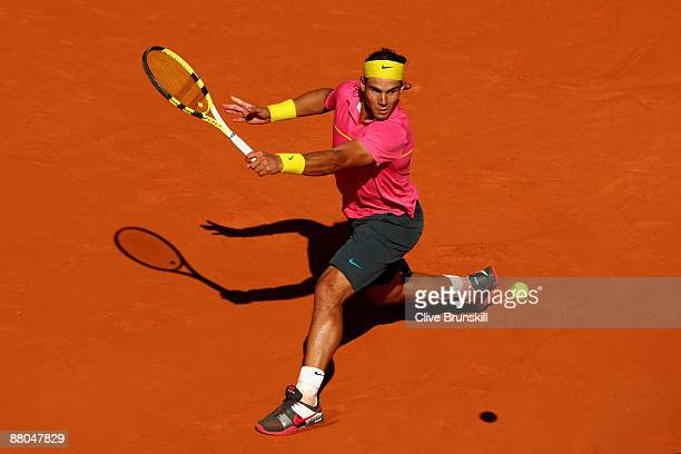 Rafael Nadal of Spain stretches for a backhand during his Men's Singles Third Round match against Lleyton Hewitt of Australia on day six of the...