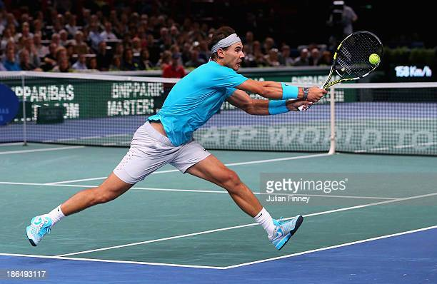 Rafael Nadal of Spain stretches for a backhand in his match against Jerzy Janowicz of Poland during day four of the BNP Paribas Masters at Palais...
