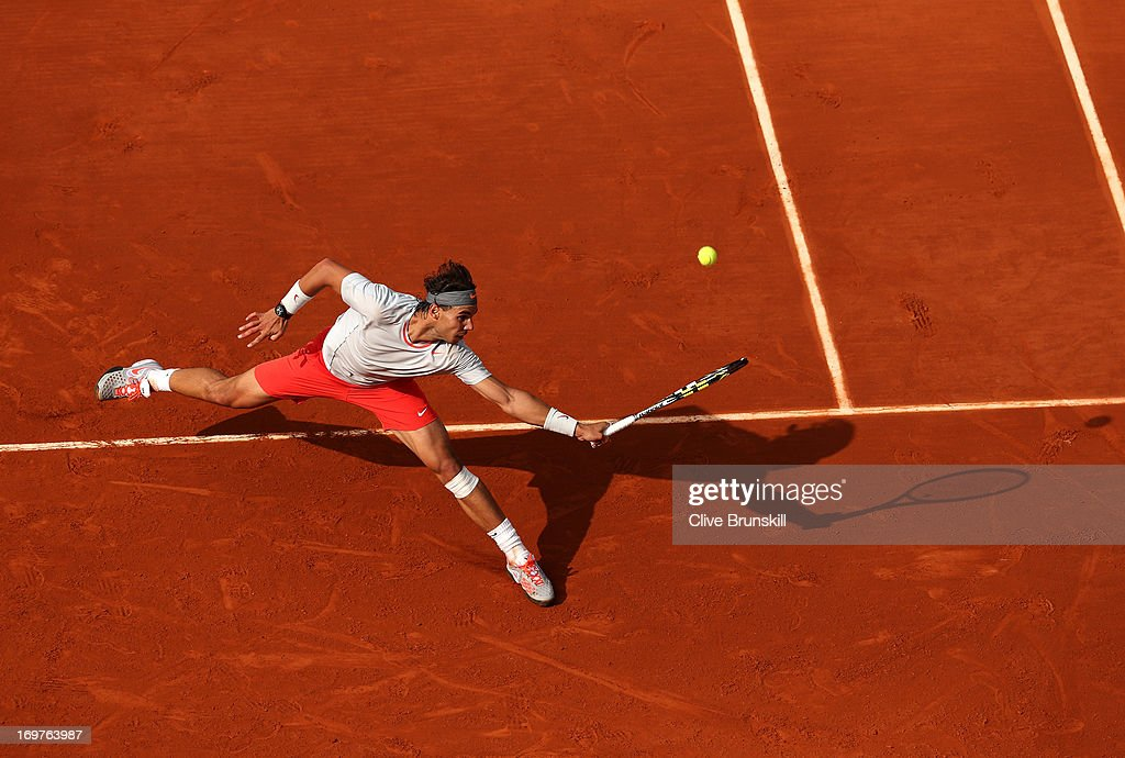 Rafael Nadal of Spain stretches for a backhand in his Men's Singles match against Fabio Fognini of Italy during day seven of the French Open at Roland Garros on June 1, 2013 in Paris, France.