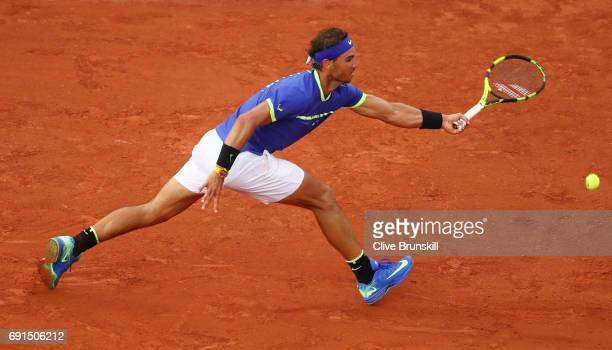 Rafael Nadal of Spain stretches to hit a forehand during the men's singles third round match against Nikoloz Basilashvili of Georgia on day six of...