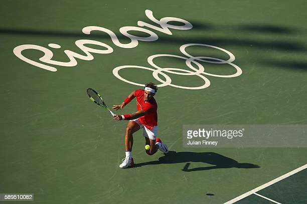 Rafael Nadal of Spain stretches to make a return during the singles bronze medal match against Kei Nishikori of Japan on Day 9 of the Rio 2016...