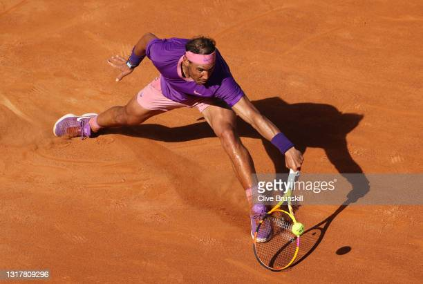 Rafael Nadal of Spain stretches to play a backhand in their mens singles third round match against Denis Shapovalov of Canada during Day Six of the...