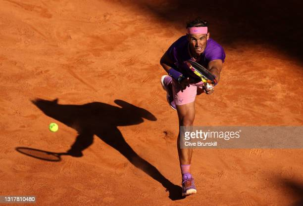 Rafael Nadal of Spain stretches to play a foreh in their mens singles third round match against Denis Shapovalov of Canada during Day Six of the...