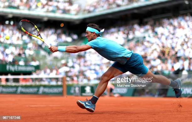 Rafael Nadal of Spain stretches to play a forehand during the mens singles fourth round match against Maximilian Marterer of Germany during day nine...