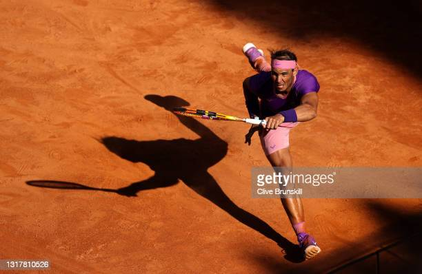Rafael Nadal of Spain stretches to play a forehand in their mens singles third round match against Denis Shapovalov of Canada during Day Six of the...