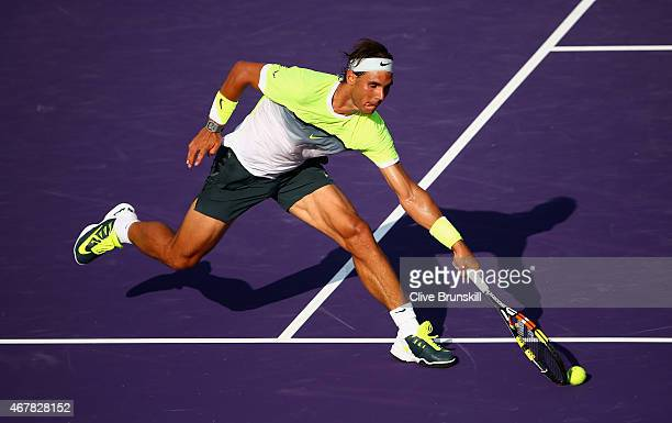 Rafael Nadal of Spain stretches to play a volley against Nicolas Almagro of Spain in their second round match during the Miami Open Presented by Itau...