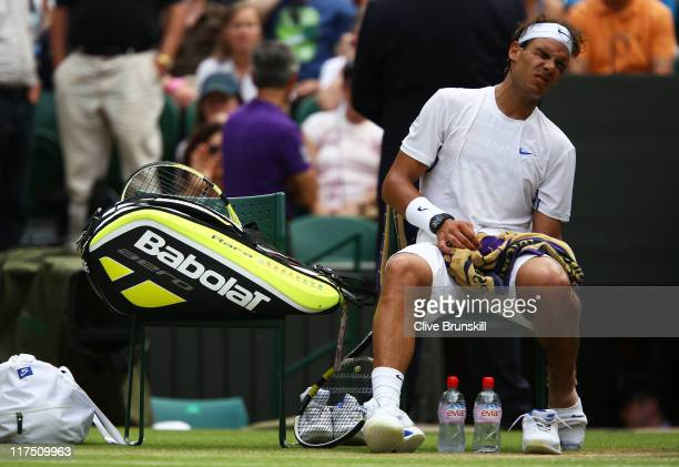 Rafael Nadal of Spain takes a break because of an injury during his fourth round match against Juan Martin Del Potro of Argentina on Day Seven of the...